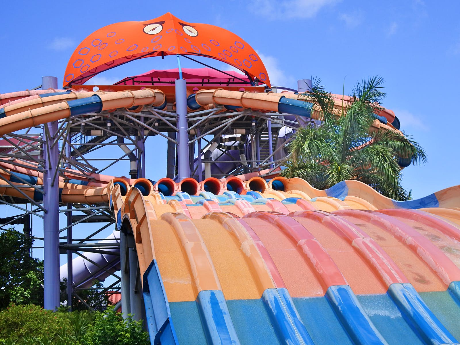 Disney alternatives - Dreamworld's WhiteWater World has a huge sea creature overseeing the 8 waterslides coming out of its mouth