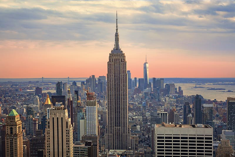 The Empire State Building at sunset is a beautiful site, but it is a New York City landscape you can skip. Instead watch the sunset from another New York City building