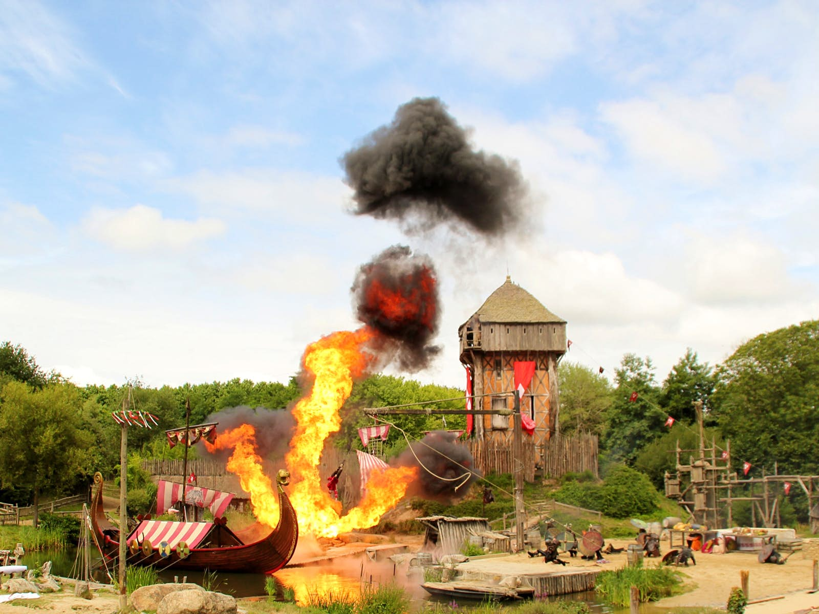 Disney alternatives - A viking re-enactment show at Puy du Fou shows a viking boat bursting into flames next to a wooden tower