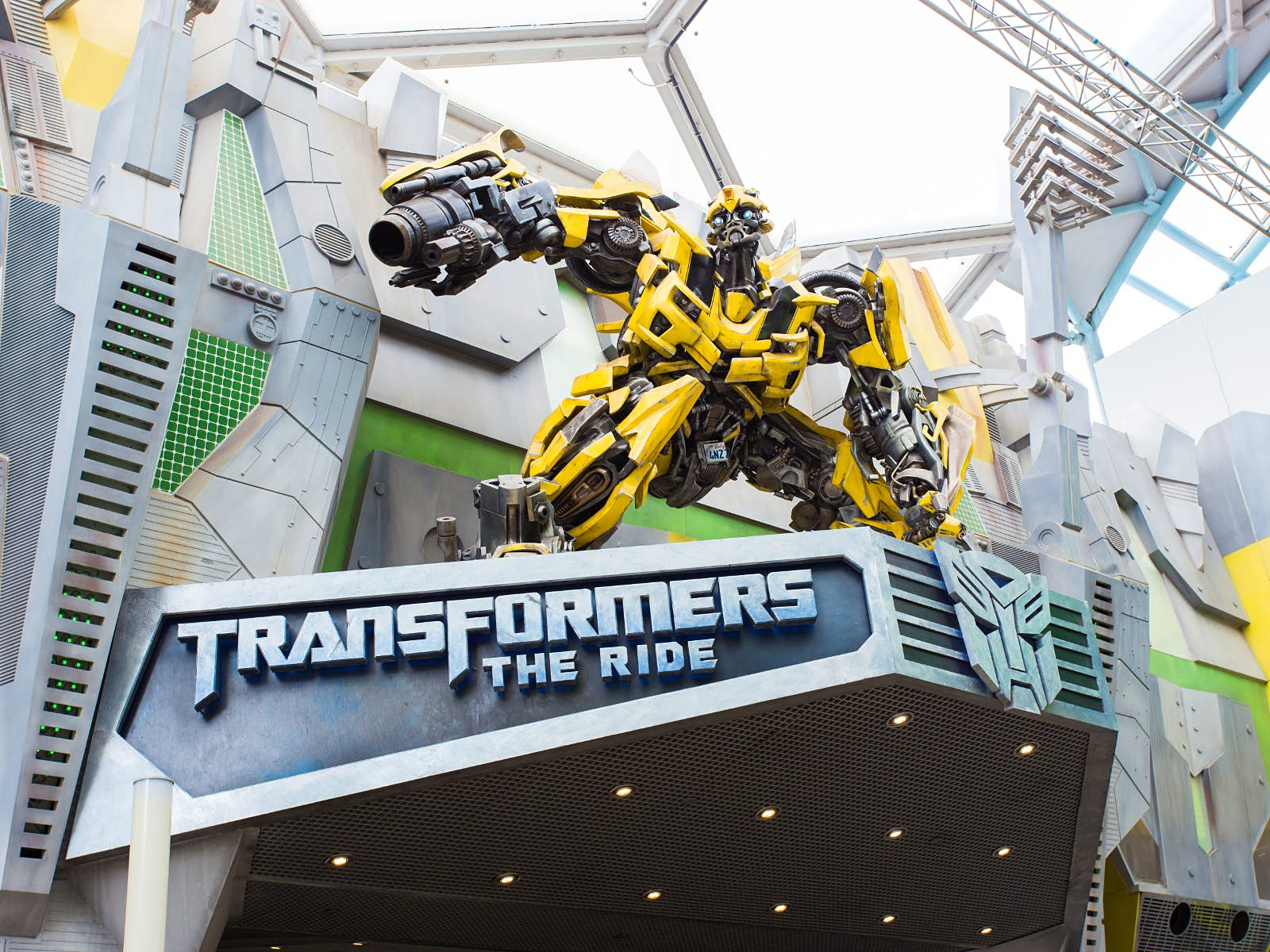 Disney alternatives - The dynamic 3D Transformers Ride at Universal Studios, Singapore. The character Bumblebee crouches above the entrance to the ride