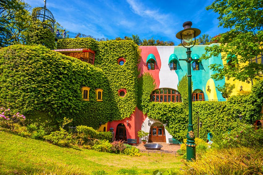 The foliage-clad, brightly coloured exterior of the Ghibli Museum in Tokyo