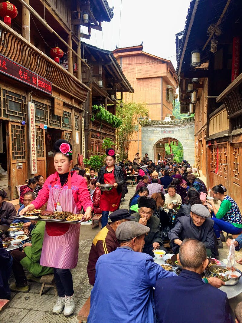 A feast being held in the traditional papermaking village of Shiqiao © Megan Eaves / Lonely Planet