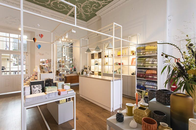 Dublin independent shops - Article's interior with white walls, shelves and tables. The surfaces are full of colourful homewares