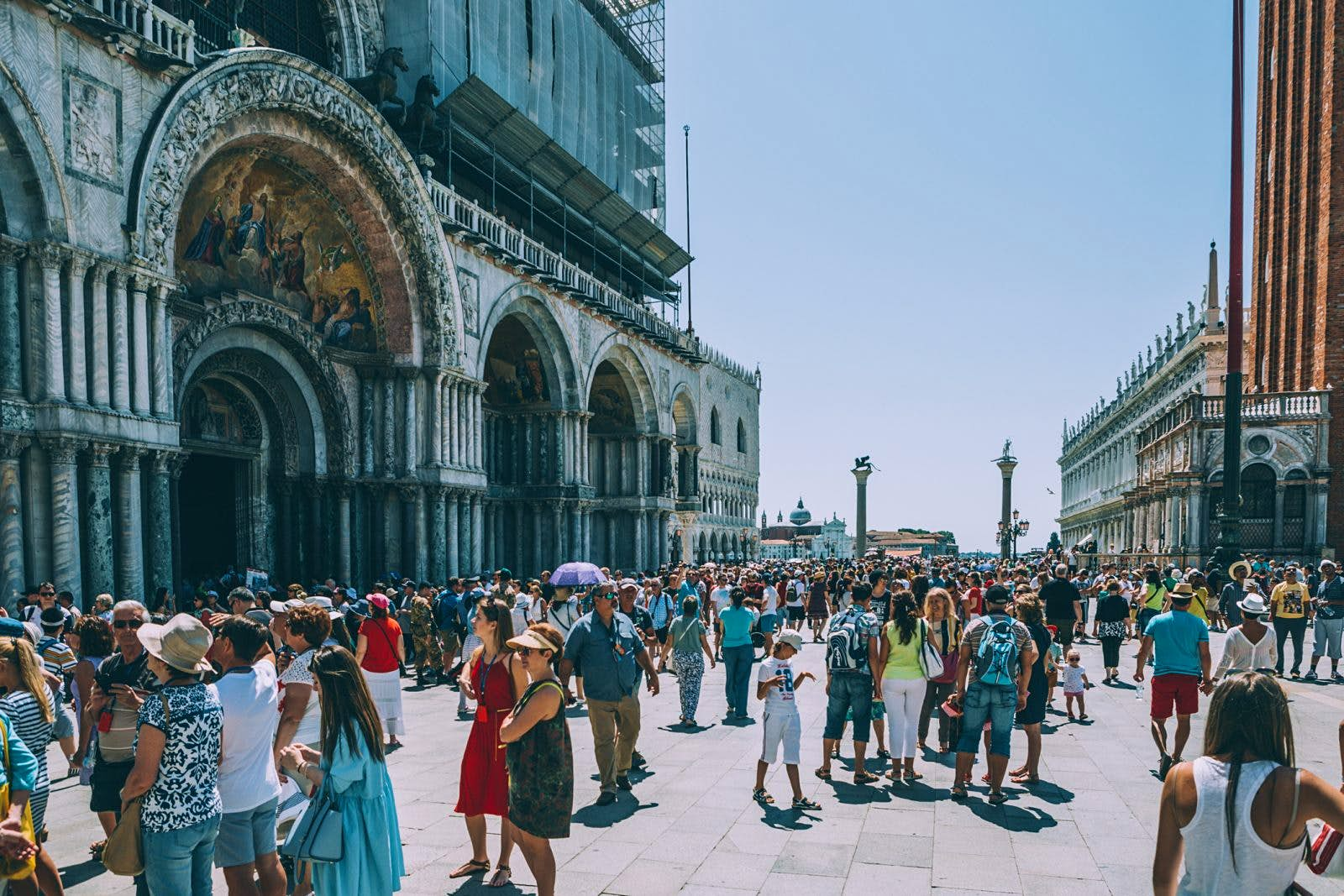 A shot of colourful tourist crowds in the streets of Venice