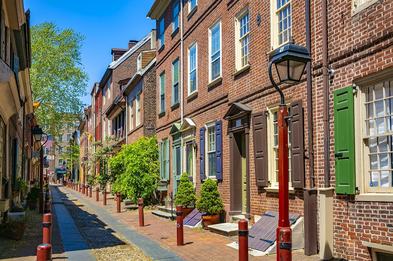 Historic brick homes line the narrow Elfreth's Alley in Philadelphia. Lafayette in the Somewhat United States is a fantastic selection for audiobooks for US road trip.