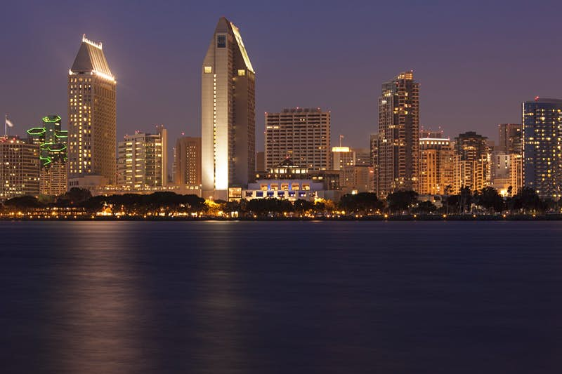 The San Diego skyline seen at night from across the bay a great city for a perfect weekend