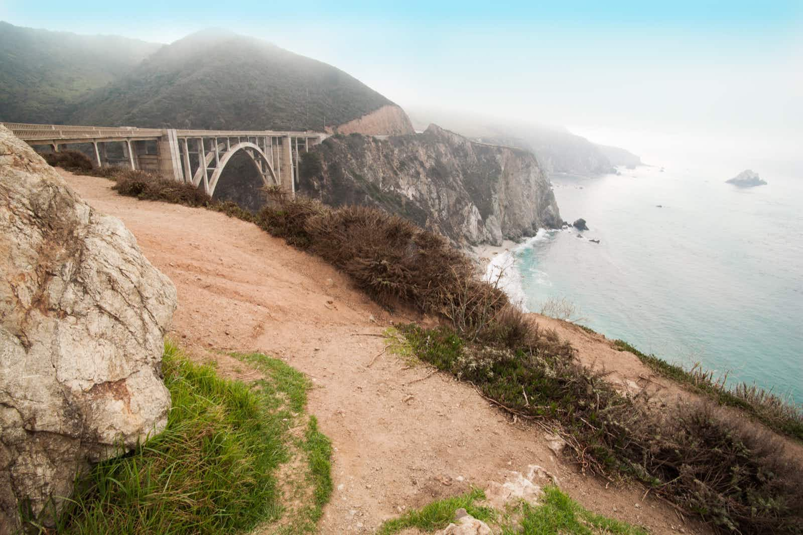 The Bixby Bridge with some fog and the ocean is a filming location in Big Little Lies