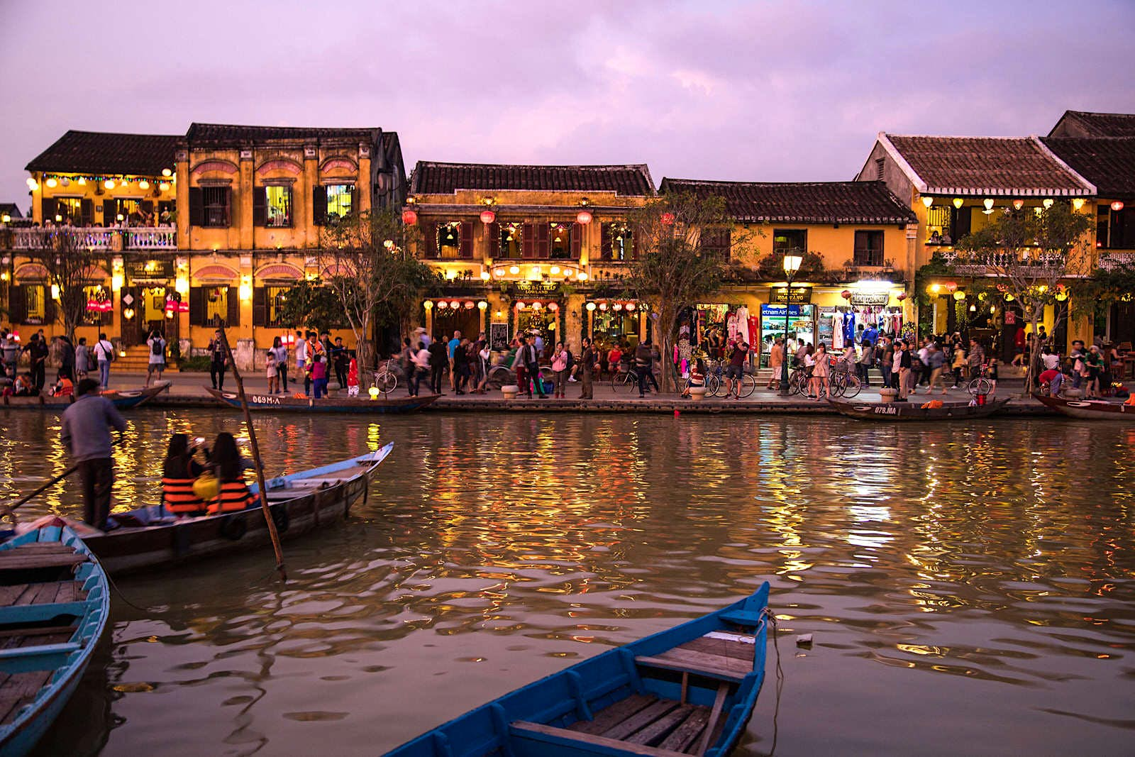 The Old Town of Hoi An viewed at dusk as lights twinkle off the river