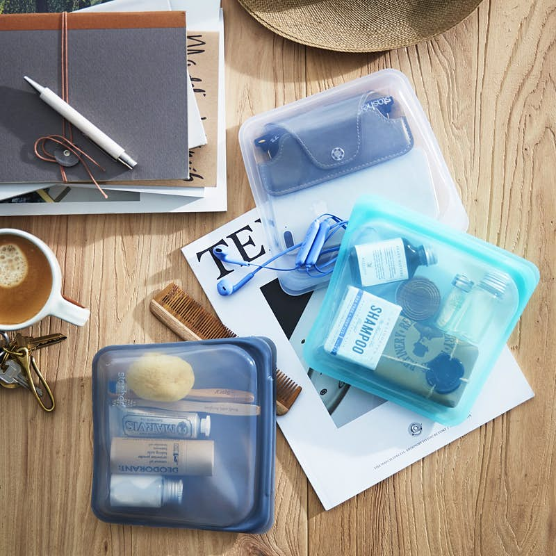 see through bags filled with a variety of personal care items on a desk