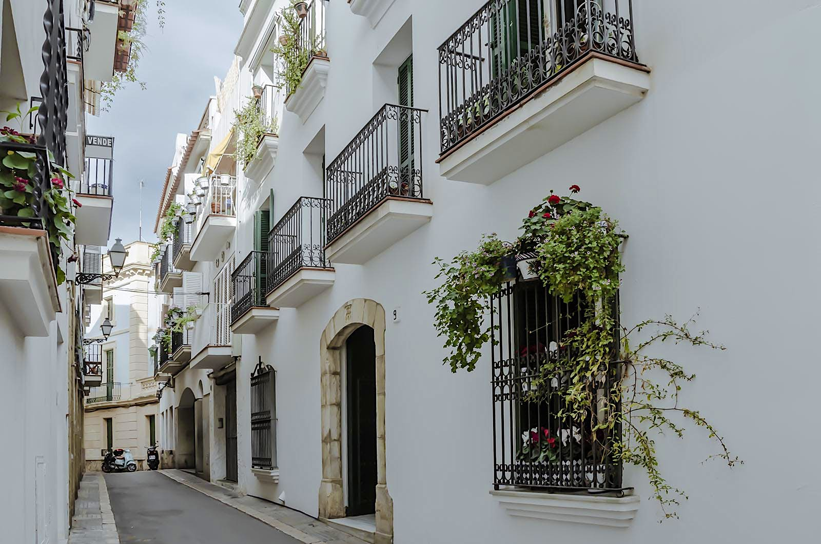 White houses in an alley in Sitges, Spain.