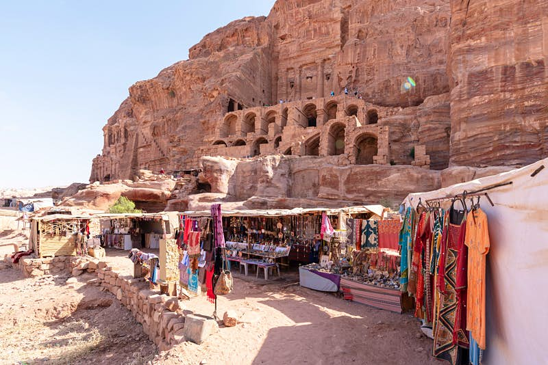 Local Bedouin operate shops in front of the Royal Tombs, Petra, Jordan