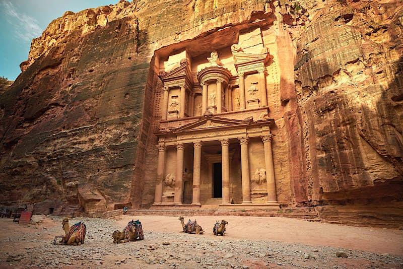 Camels rest in front of Al Khazneh, the Treasury, Petra, Jordan