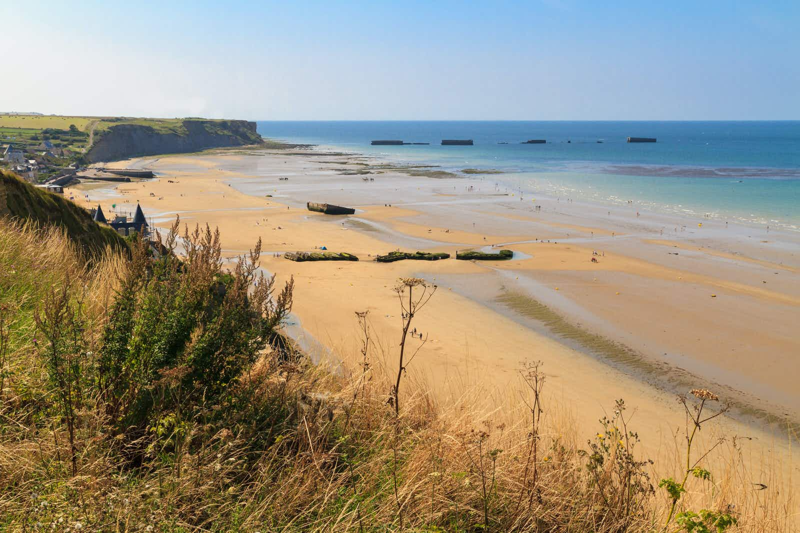 The remains of a Mulberry Harbour (artificial port) at Arromanches-les-Bains in Normandy © Bertl123 / Shutterstock