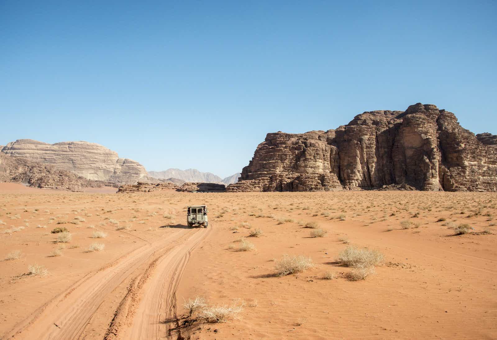 Pick-up truck in the desert in Wadi Rum, Jordan