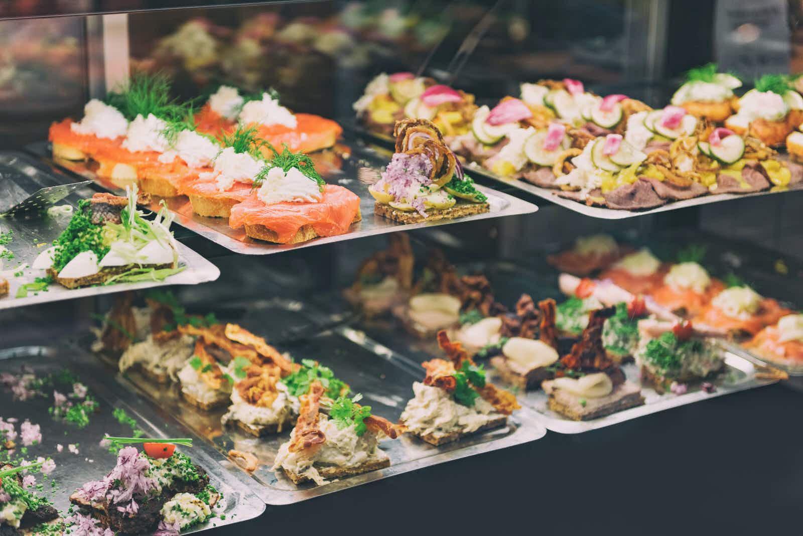 A selection of Danish smørrebrød, traditional open-faced sandwiches,  at Torvehallerne © Maridav / Shutterstock