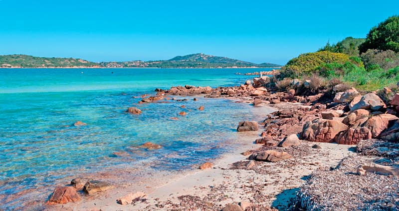 Azure waters near a rocky shore; best things to do in Sardinia