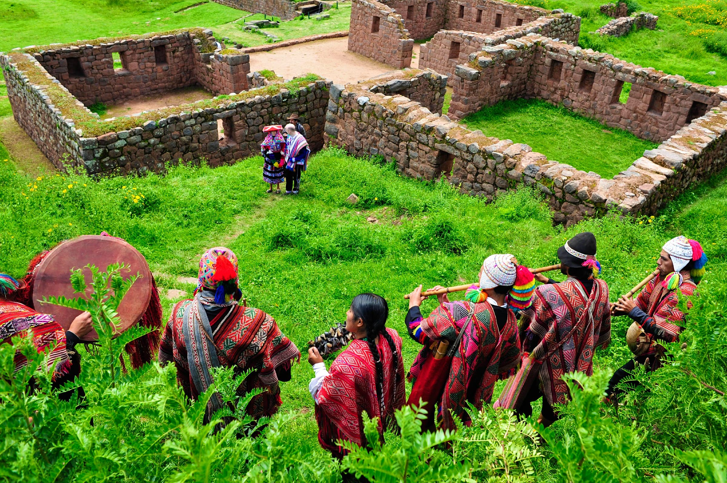 Traditional peruvian wedding ceremony at the Temple of Water ruins in Sacred Valley near Cuzco