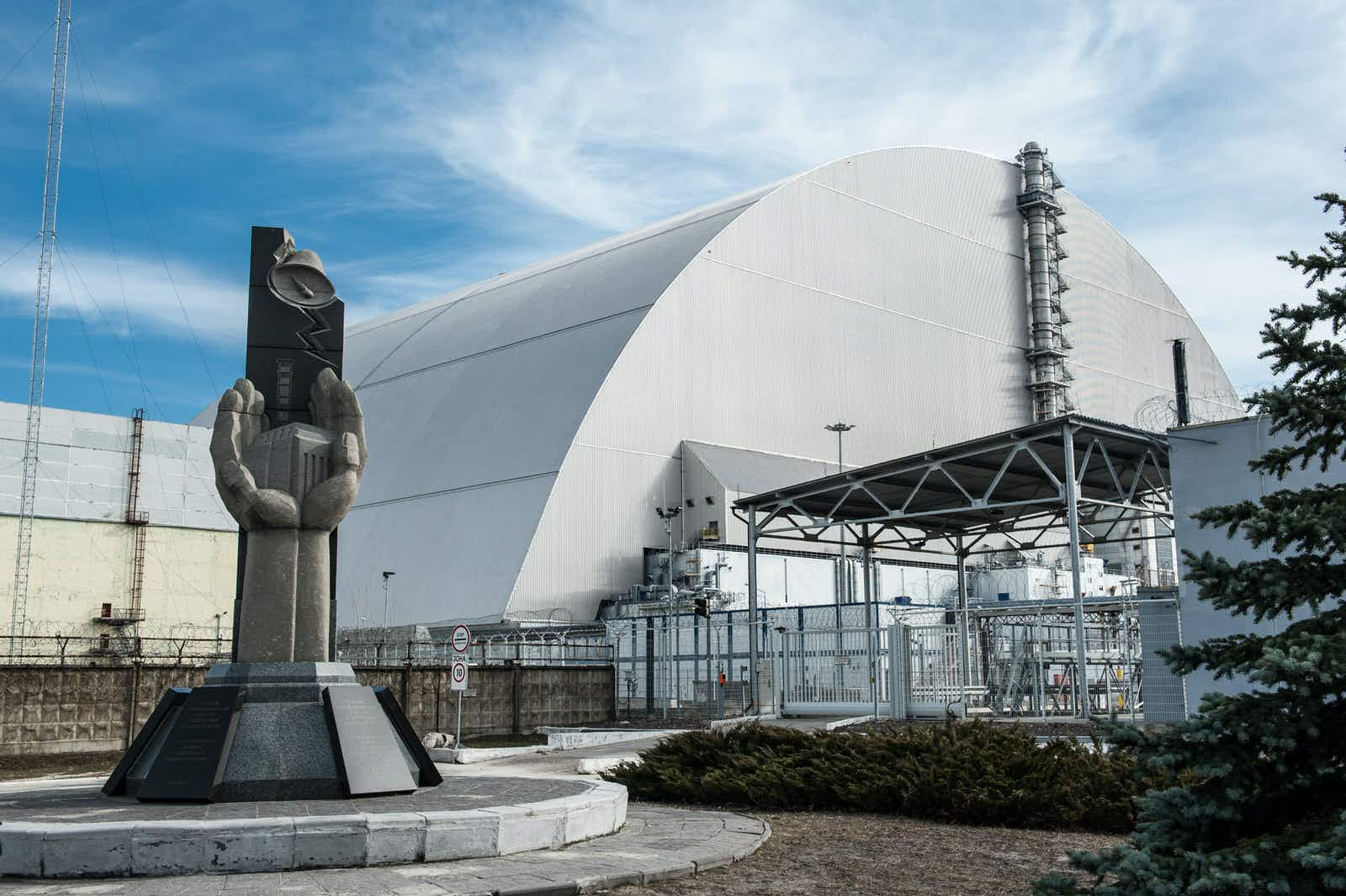 The New Safe Confinement structure around the remains of Reactor 4 at Chernobyl © Olga Vladimirova / Shutterstock