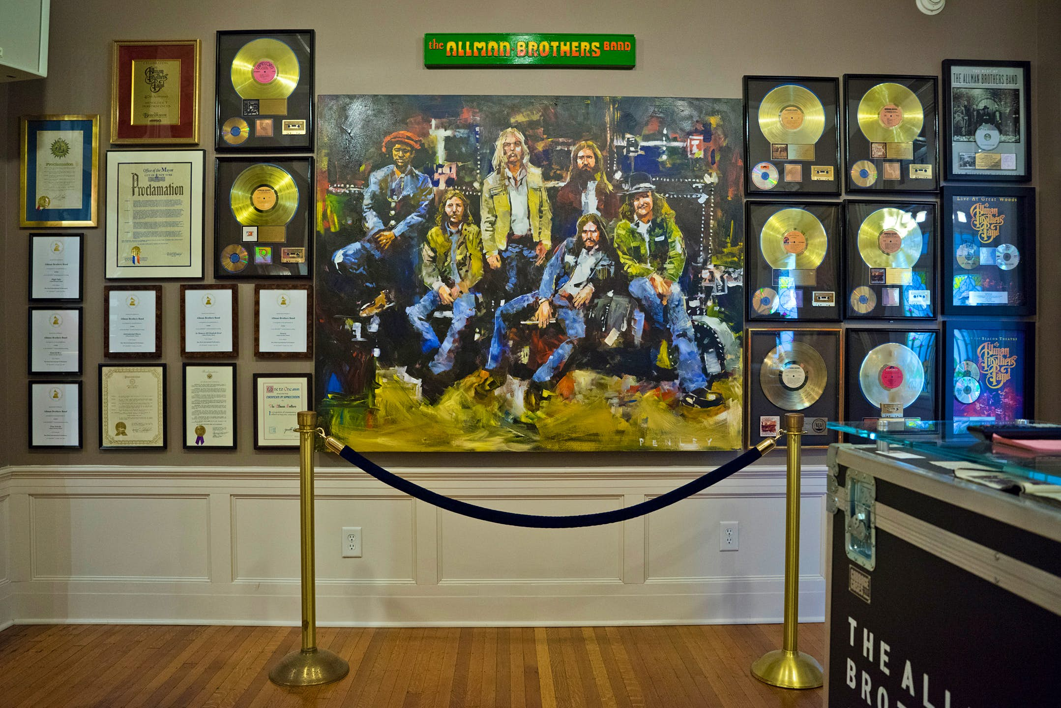 A large image of the Allman Brothers and gold records line the interior of the museum; USA museums for music lovers