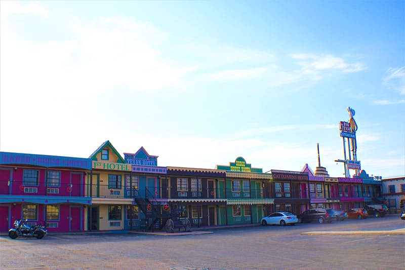 Exterior of the Big Texan, made up to look like an Old West town with brightly colored facades