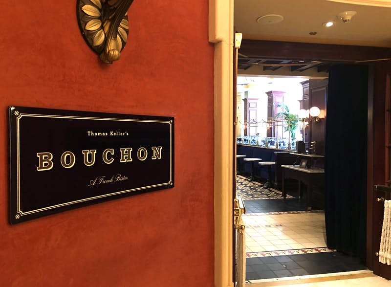 A small black sign marks the entrance to Bouchon, a celebrity chef restaurant in Las Vegas