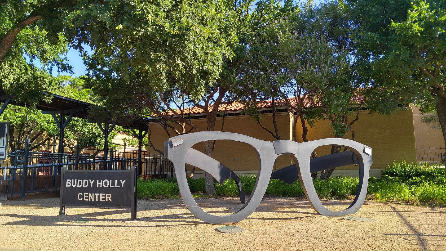 A large pair of Buddy Holly's signature sunglasses sit outside the Buddy Holly Center. USA museums for music lovers