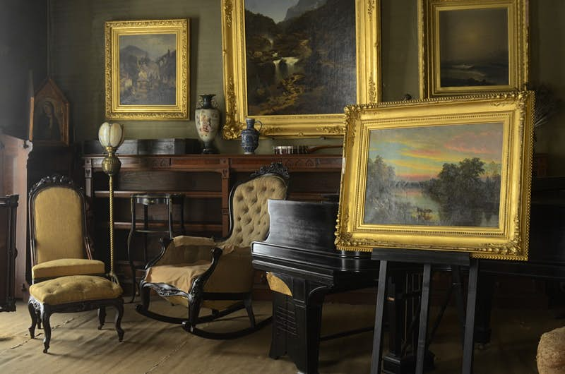 Paintings inside the Emily Dickinson Museum; historic homes