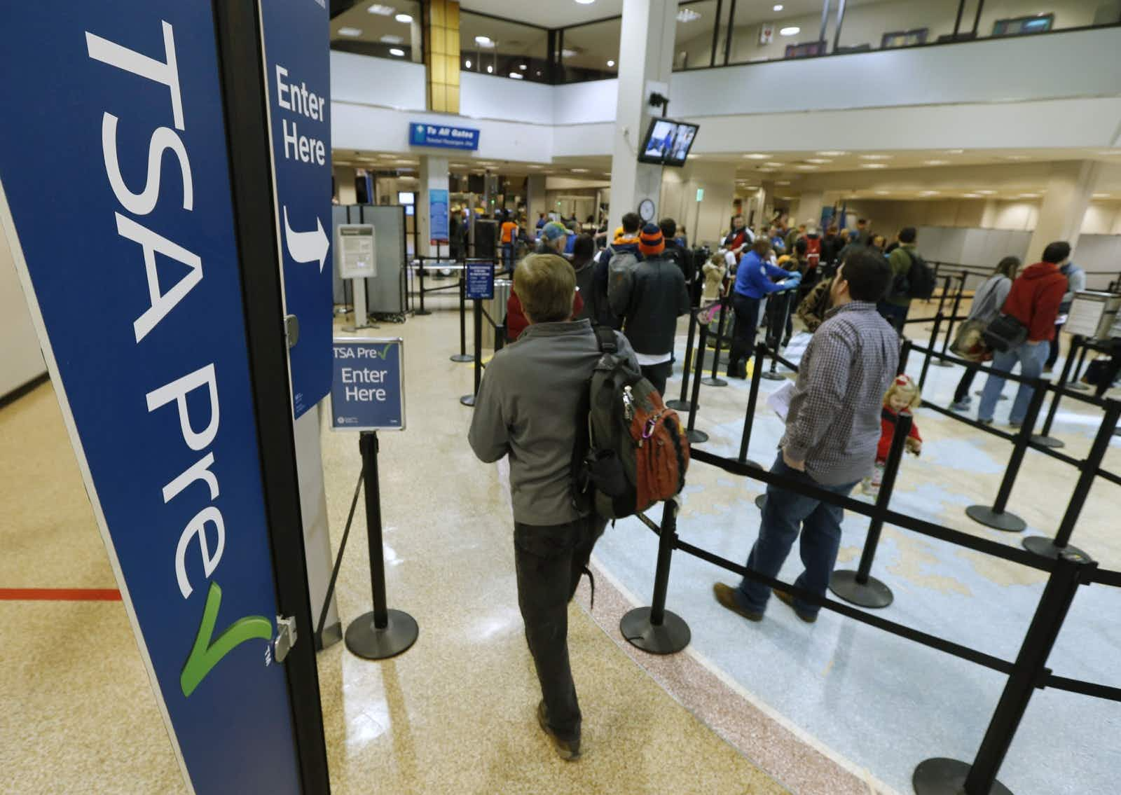 Passengers enter the TSA pre boarding line and make their way through a TSA security check point at the Salt Lake City International Airport; Equifax