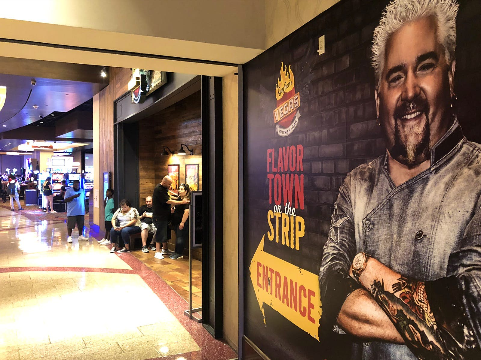 A large mural of celebrity chef Guy Fieri points the way to his restaurant in a Las Vegas casino