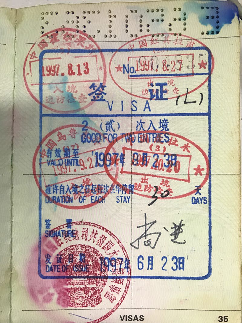An old passport page showing Chinese double-entry visa stamps