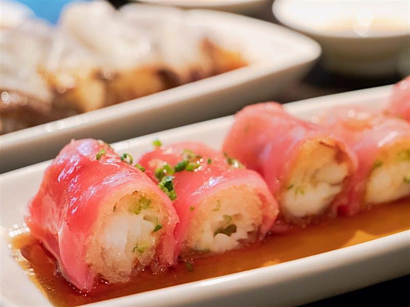 A close up of king prawn silver cod crispy red rice cheung fun at Hakkasan