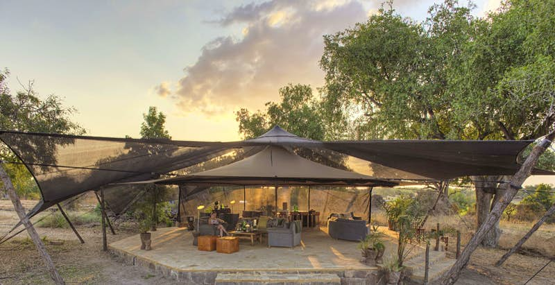 A canopy covering a lounge area under a sunny sky; all-inclusive resort adventures
