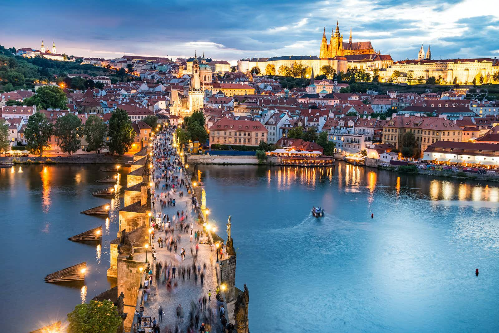Prague Castle looms above the Vltava's left bank and Charles Bridge © NaughtyNut / Shutterstock