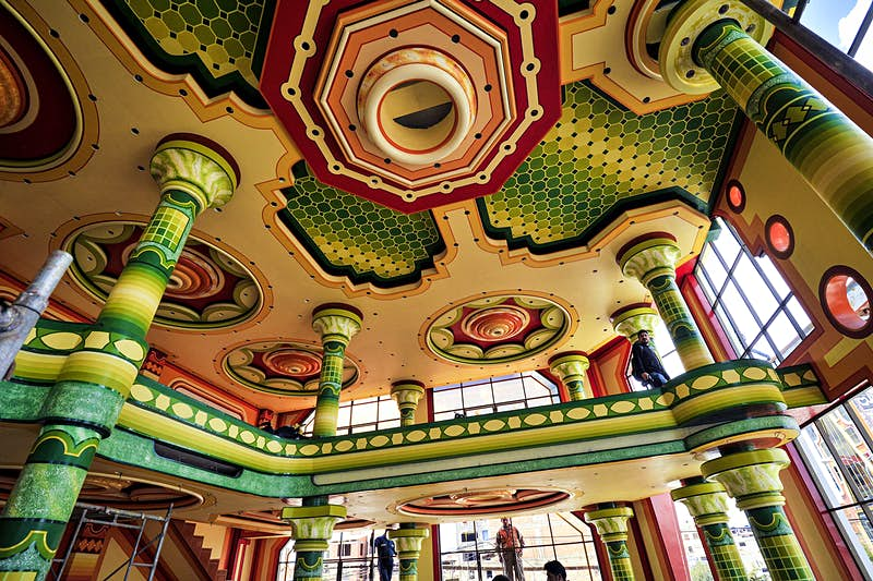 A colorful ceiling of a New Andean mansion features yellow, green, orange and red designs. La Paz, Bolivia.