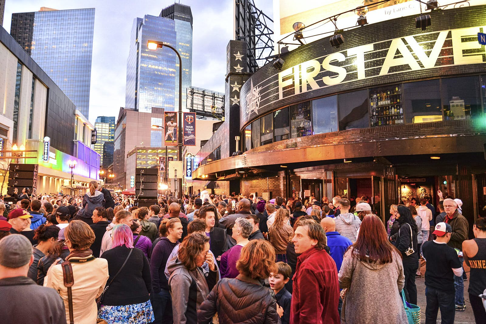 First Avenue Music Venue in Minneapolis: crowds of people stand outside the large venue with 'First Avenue' written in huge gold writing across it