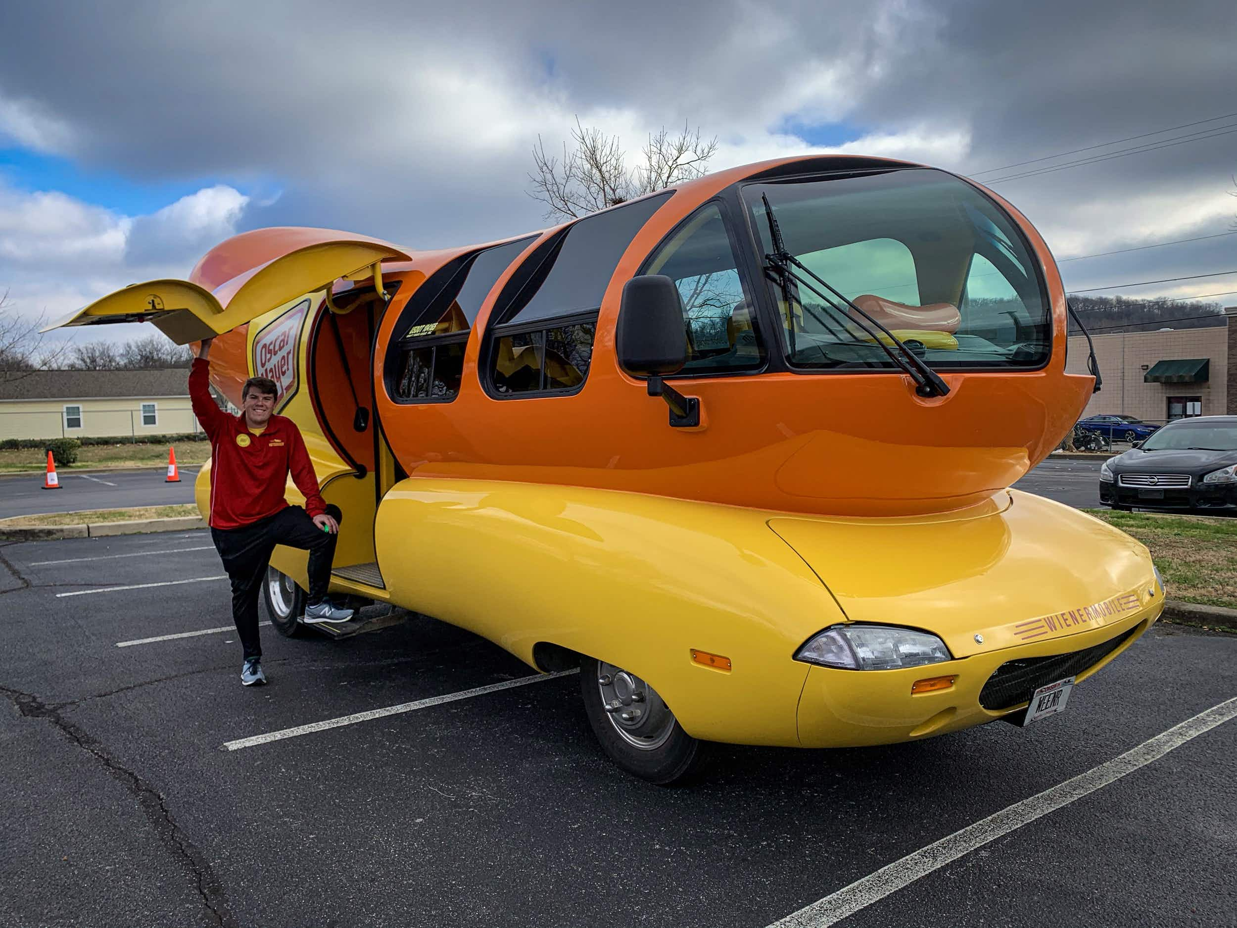 Wherever the Oscar Mayer Wienermobile travels, happy people follow. Alex Hale is one of the 'Hotdoggers' who drives the sausage across the USA © Bailey Freeman / Lonely Planet