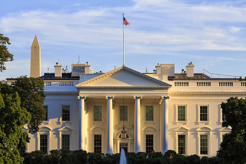 The front portico of the White House is seen in early evening, with the Washington Monument poking up behind; Best American architecture