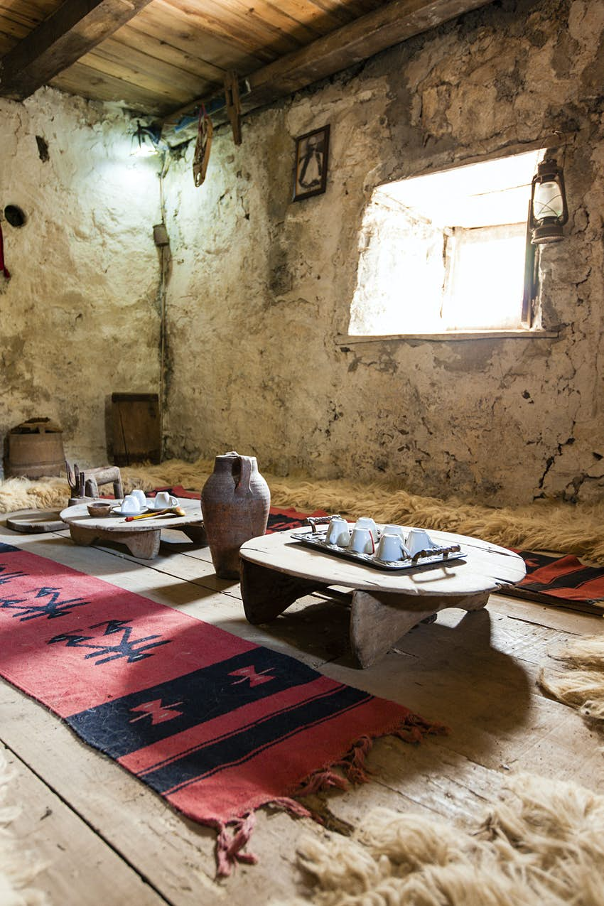 Low tables and geometric rugs laid out inside the lock-in tower