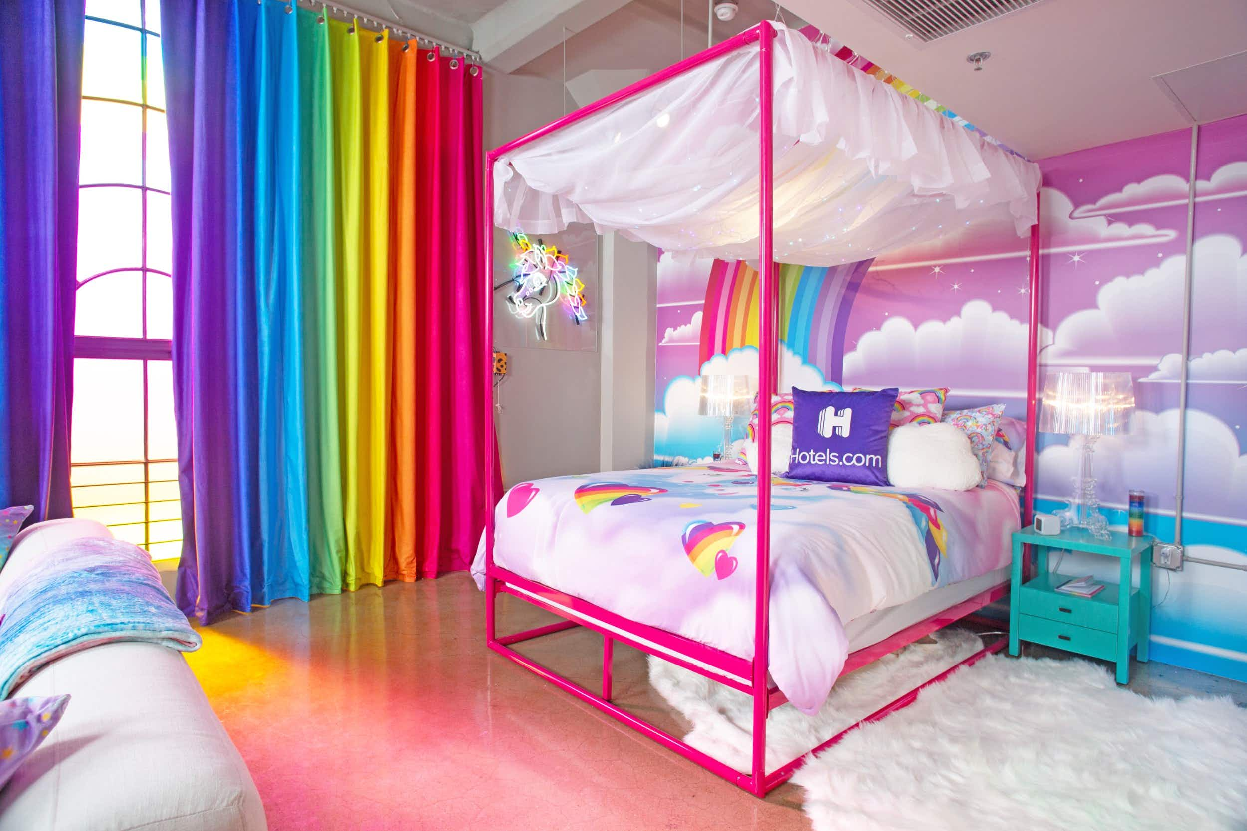 The colorful bedroom at the Lisa Frank Flat © Hotels.com