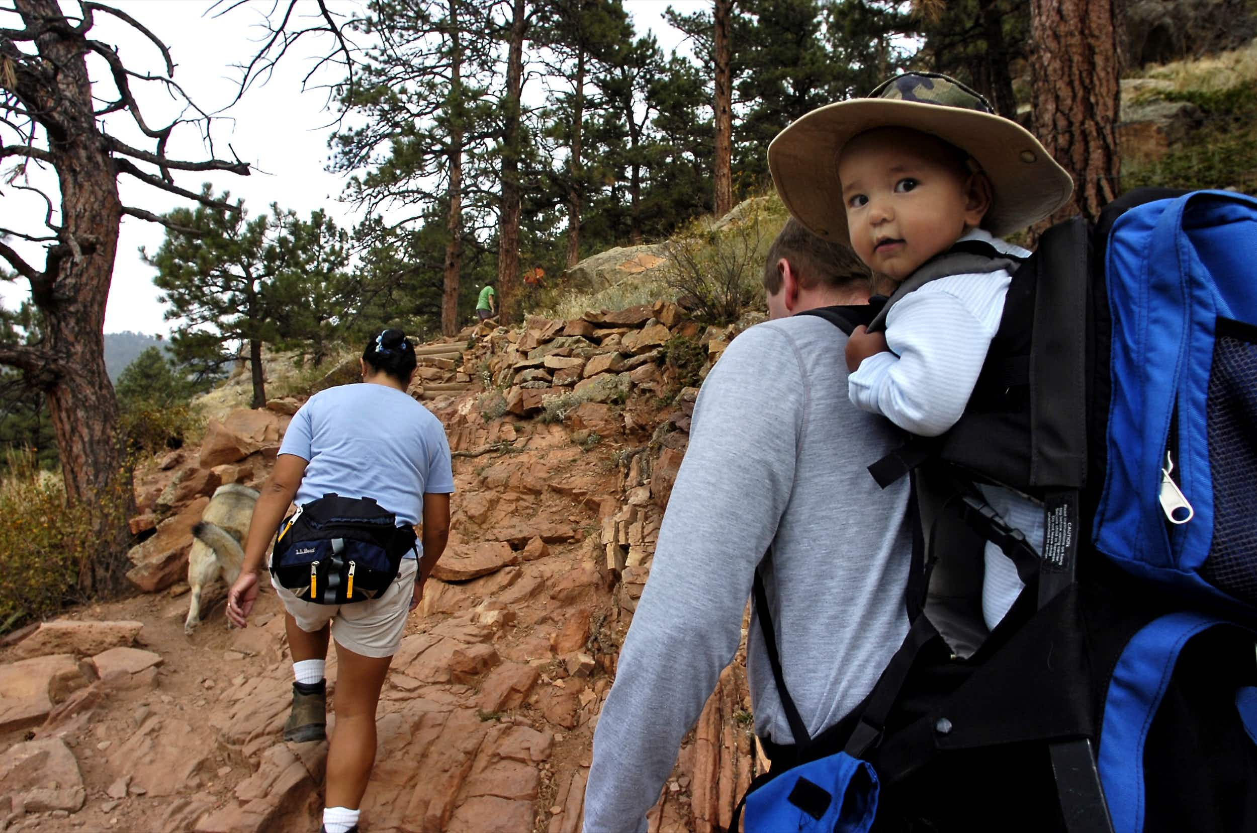 A couple hikes with their nine-month-old son at Mt. Sanitas near Boulder. The trails have something for everyone. © Marty Caivano / Digital First Media / Boulder Daily Camera via Getty Images