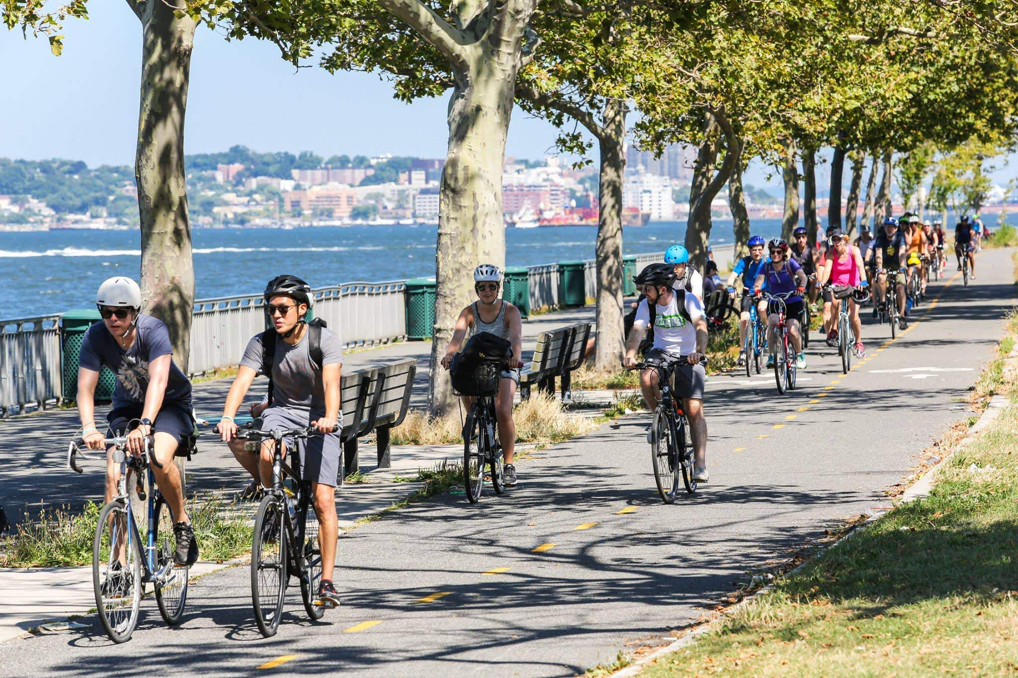 A line of cyclists on the Brooklyn waterfront