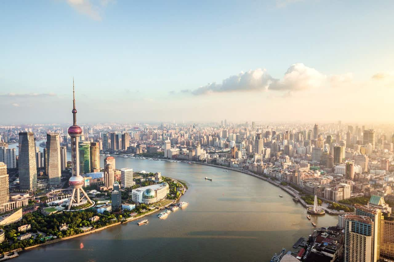 Elevated view of Lujiazui financial district and the Bund skyline at dusk; Shanghai, China.