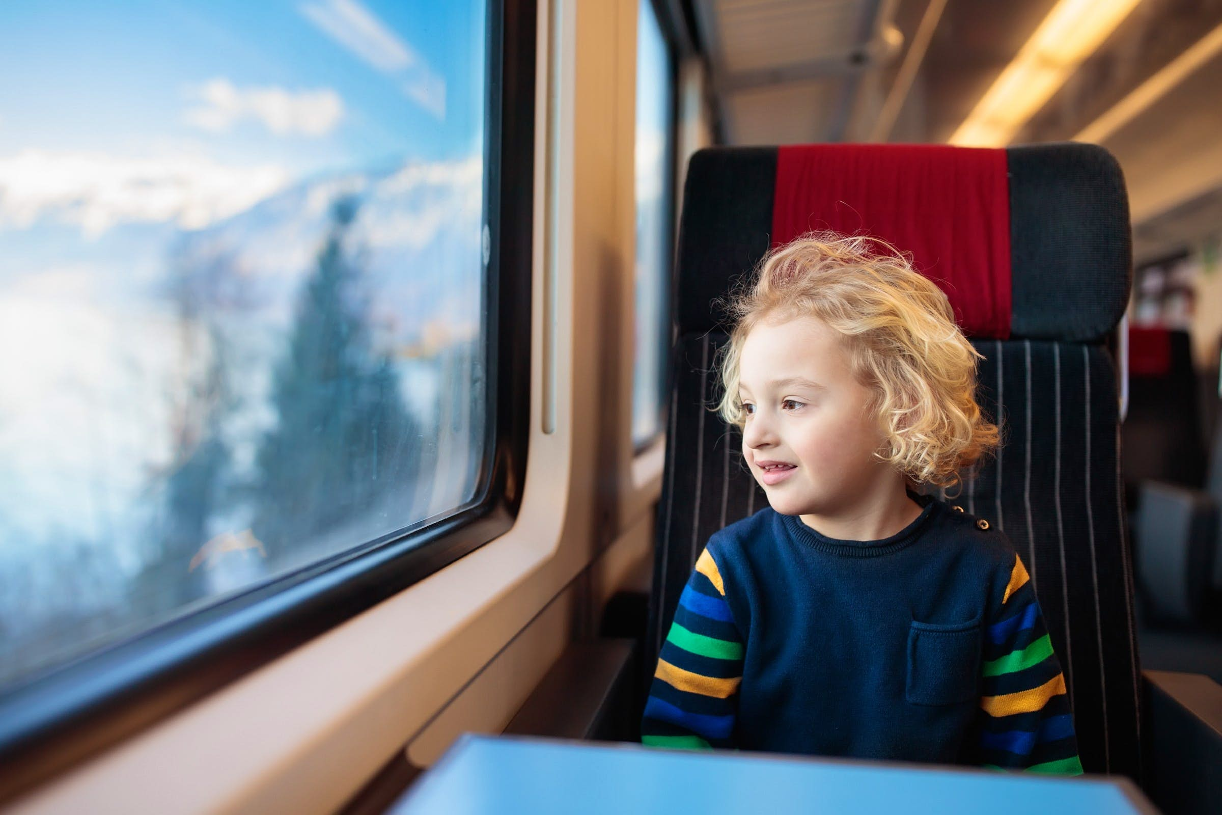 Child travelling by train through the German countryside.