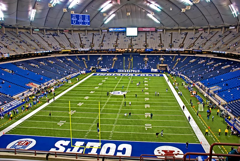 Aerial view of the inside of a sparsely populated Lucas Oil Stadium, home of the Indianapolis Colts; nfl cities travel