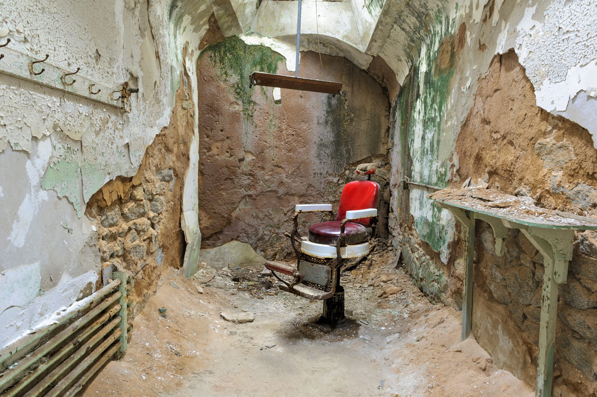 A barber's chair lies within the ruins of Eastern State Penitentiary, in Pennsylvania