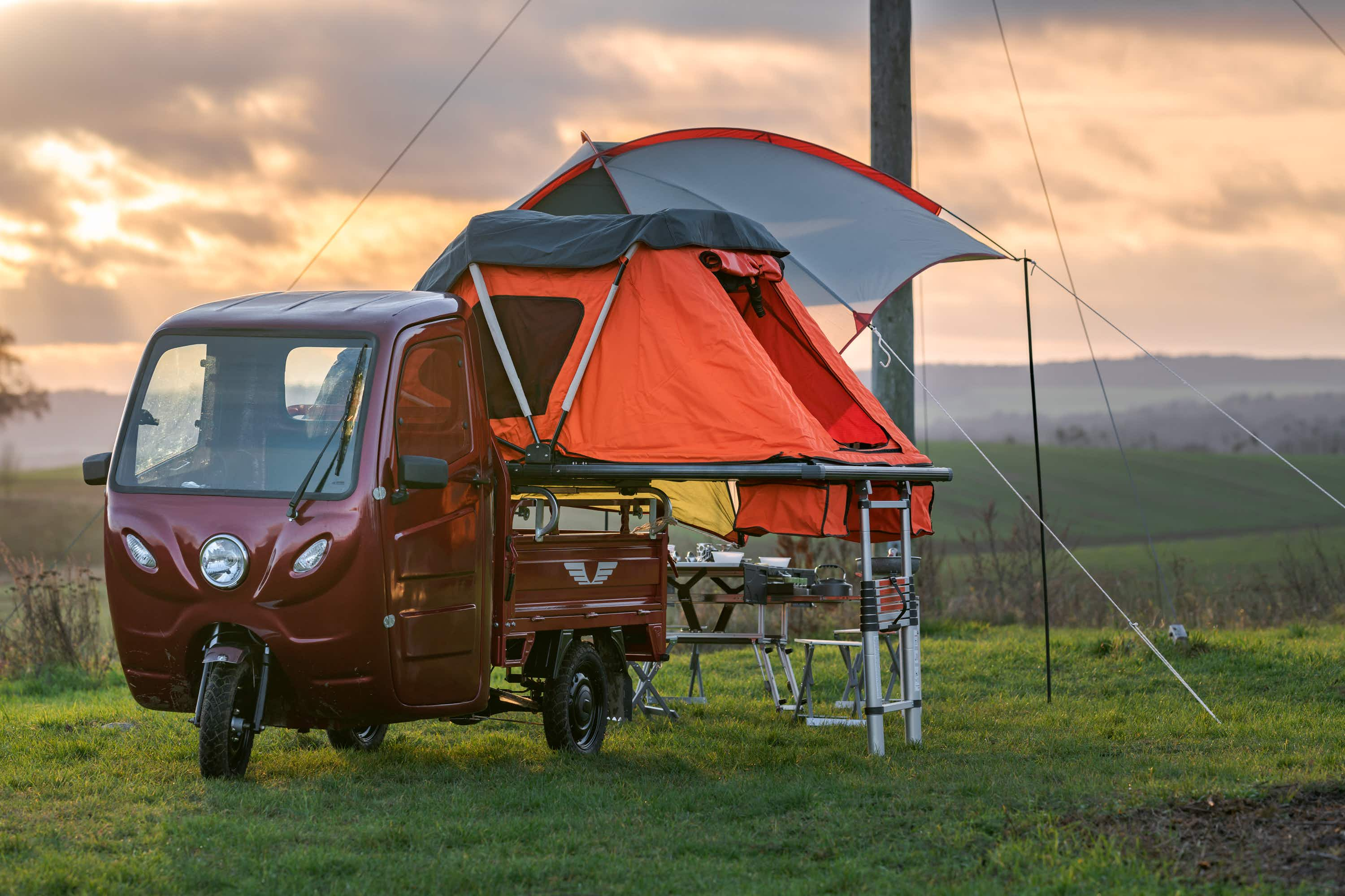 This eye-catching electric tricycle quickly transforms into a micro camper
