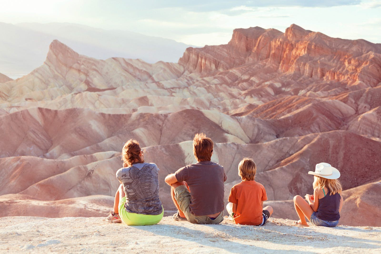 A family of four admires the view at Death Valley