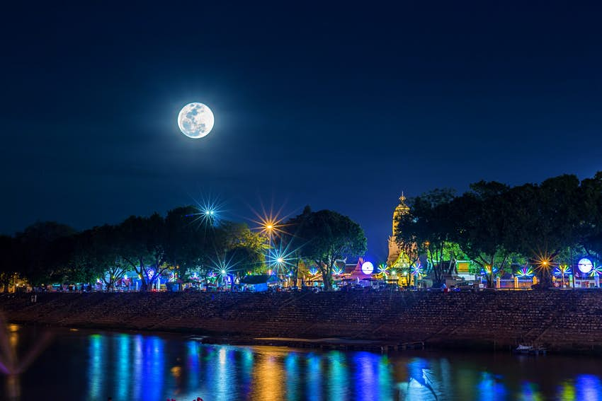 A super moon over a temple in Phitsanulok, Thailand