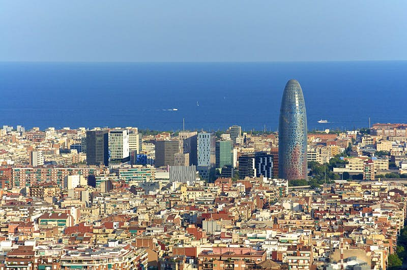 Looking over the skyline of Poblenou, with modern skyscrapers in the background and the blue Mediterranean beyond.