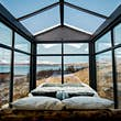 There are few better ways to soak up Iceland's midnight sun than in a glass cabin @ Courtesy of Panorama Glass Lodge